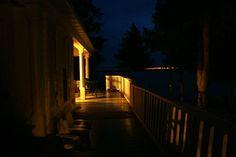 Looking toward Cameron Lake at night from the cottage veranda.