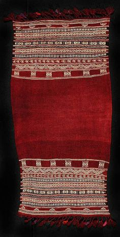 Africa | Red wool Tunisian kitfeya that would have been worn around the shoulders of the women in times past. | It has cream cotton woven designs and some black woven striped background