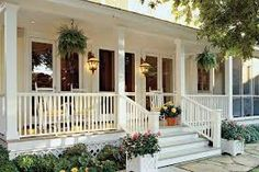 Classic White Porch - 80 Breezy Porches and Patios - Southernliving. Hanging ferns area a classic look for any Southern porch. Container gardens and a lush border add color to this space. Porches: Creating the Space Farmhouse Front Porches, Southern Porches, Southern Living, Southern Homes, Country Porches, Country Houses, Hanging Ferns, Hanging Baskets, Hanging Plants Outdoor