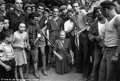 A French woman accused of sleeping with Germans has her head shaved by neighbors in a village near Marseilles: HISTORY ARTICLE:The year of vengeance: How neighbours turned on each other as anarchy erupted in Europe in the aftermath of WWII. http://www.dailymail.co.uk/news/article-2119589/The-year-vengeance.html?ICO=most_read_module