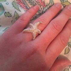 Super Cute Starfish ring! Such an adorable ring!! It's in excellent condition -- it's missing one jewel, however it's kind of on the side so not noticeable when wearing! Jewelry Rings