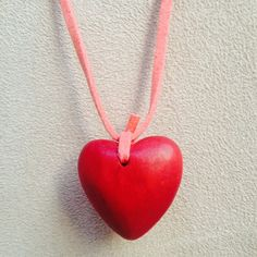 Heart Shaped Wooden Necklace This beautiful necklace is like new and perfect for Valentine's Day! Has an adjustable clasp, measures about 19-21 inches in circumference. The heart is approximately an inch in diameter. The third picture is the back of the heart. Jewelry Necklaces