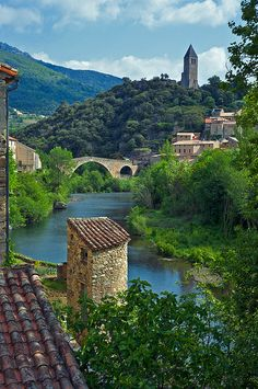 One of the most beautiful villages in France, The ruined 11th century chateau and the 13th century Devil's Bridge (Le Pont du Diable) in the village of Olargues.