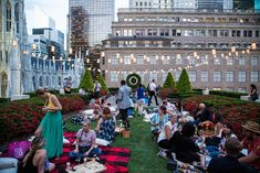Guests were encouraged to chat and enjoy their beverages and hors d'oeuvres picnic-style on plaid blankets from the collection, while listening to jazz music from a three-man band.