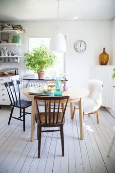 """this kitchen is beautiful! Open, full of light and bright accents, and I love mismatched chairs...looks more lived-in and not a """"show kitchen"""""""