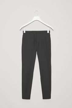 COS image 4 of Tapered slim trousers in Black