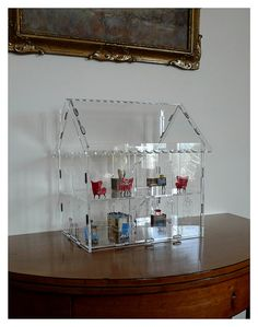 Acrylic dollshouse by keith bougourd, via Flickr- what a cool idea, so your miniatures are showcased.
