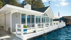 On a deck—or dock, in this instance—that's relatively narrow, you can make the space feel more expansive by installing horizontal balusters with ample space between them. This railing is painted White Dove by Benjamin Moore, and something similar can be created by a contractor in your area.
