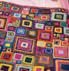 I'm making baby girl's baby blanket like this. . . varying sizes of granny squares in her room's color scheme