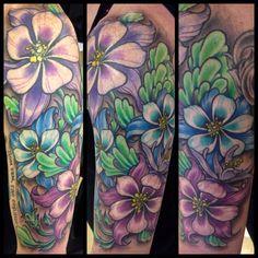 Ben gun flower tattoo