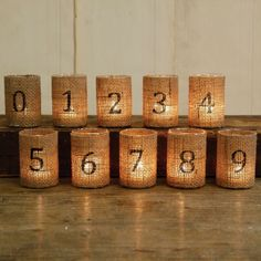 Burlap Wedding Details - Burlap Votive Table Numbers... Could also see these with velium in place of the burlap