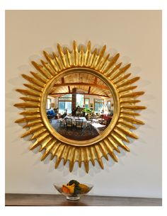 The Solarburst mirror is a bold design by Canner with an extra large convex mirror. This modern, Radiating mirror celebrates new findings in space that will add splash to important places in an interior. Shown in Antique Gold leaf... Carol Canner Designer / Sculptor
