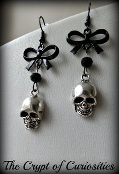 A lovely Gothic pair of earrings made up from antique silver human skull charms which hang from black plated bow connectors with added black glass crystal beads. Lead and nickel free Earrings measure approx 2 inches long. Goth Jewelry, Skull Jewelry, Jewelry Accessories, Skull Rings, Jewelry Design, Cute Earrings, Dangle Earrings, Choker Necklaces, Diamond Earrings