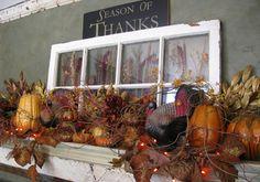 Fall mantel - gourds, autumn leaf garland, old window pane.  Beautiful!