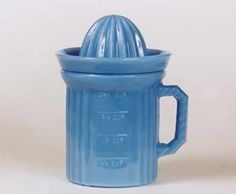 A one-cup measure with a reamer top has been reproduced in opaque blue glass commonly referred to as Delphite by collectors. Follow us on www.facebook.com/RealOrRepro powered by RubyLane.com