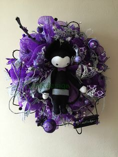 Halloween Wreath. My name is Vladislav. And i am a little crocheted vampire. My base is purple deco mesh with tons of ribbon strips. Next you can find there different handmade embellishments, such as glittered eyes, spiders, pinecones, branch and tiny bottles. Also there is a wooden board with my name on it. No don´t worry, i am not a bad vampire and i am suitable only for indoor decoration. My wreath meassures around 45 cm.
