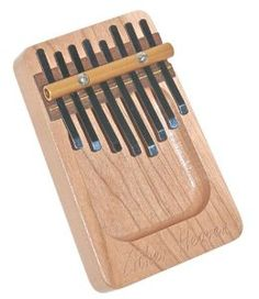 Amazon.com: Zither Heaven 8 Note Cherry Dished Thumb Piano (Kalimba): Musical Instruments (May look for something like this at a local music shop)