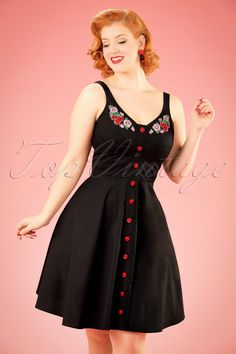 This 50s Lulu Cherry Swing Dressis going to be the key item in your rockabella wardrobe!Put on your pumps and play your favourite record because it's time to dance of joy! The fitted top and swing skirt ensures a super feminine silhouette, oh la la. It looks like a button down dress but nothing less is true; it's a row of faux buttons. The sturdy yet supple, black cotton blend has a light stretch and is a joy to wear. Oh, and did we already mention the stunning embroidery?! ...