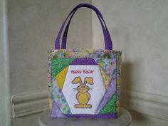Super cute Easter basket for the kids!  Easter Tote Appliqued Quilted and Embroidered by StitchersCupboard, $20.00
