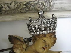 cherub with a crown