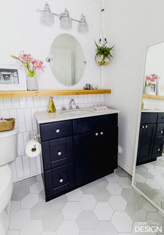 *This post is sponsored by The Home Depot Today, I'm super excited to revealour latest bathroom makeover! If I were a student again, writing a paper on how I spent my Christmas vacation, I could honestly say I remodeled a bathroom! While it's not a typical way to spend a holiday,I'd say it was time …