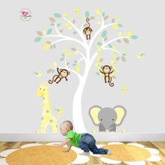 Enchanted Interiors Jungle Wall Sticker Decals Premium Self Adhesive Fabric Nursery Wall Art  Approx Scene Size: 64 high x 53 wide Can be positioned from the skirting board up or above nursery room furniture.  Captivate your babys imagination with our friendly jungle animals nursery wall art scene featuring a friendly giraffe, elephant, and of course lots of cheeky monkeys. Simply peel and stick to transform your baby nursery room within hours.  Included in the Safari Wall Stickers Scene are…