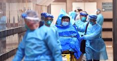 Medical staff transfer a patient of a highly suspected case of a new coronavirus at the Queen Elizabeth Hospital in Hong Kong, China January Picture taken January cnsphoto via R…