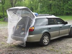 When I am parked overnight where I feel comfortable I will use this $3 jungle hammock netting. Just drape over the hatchback.  Budget Travel - Expedition Portal