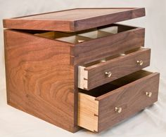 This box was custom designed to have 18 compartments for teas – 9 in the top area and an additional 9 in the first drawer. The bottom drawer was designed to hold tea ware. The case and lid are joined with through dovetails. The dovetails...