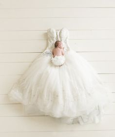 Jessica V Photography beautiful baby on mom's wedding dress. Don't you love the simplicity of this photo? Newborn Photography