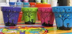 brightly painted flower pots with Halloween tree and black cat Flower Pot Art, Clay Flower Pots, Flower Pot Crafts, Clay Pots, Clay Pot Projects, Clay Pot Crafts, Crafts To Make, Flower Pot People, Clay Pot People