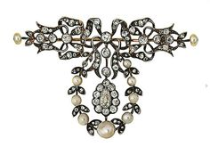 A late 19th century pearl and diamond brooch   Designed as a series of old brilliant and rose-cut diamond ribbons suspending a pear-shaped knife-edge bar garland mounted with rose-cut diamond leaves and pearl buds surrounding a central old-cut and pear-shaped diamond cluster, circa 1890, later converted, central cluster later replacement, 6.5cm wide