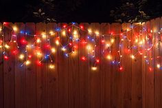 Create a Patriotic Fence line with Icicle String Lights. This idea is perfect for Memorial day, July 4th and Christmas too!