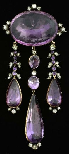 A Victorian girandole brooch. Set with amethysts and diamonds in a floral setting, mounted in silver and gold. 11.5cm long. #Victorian #brooch