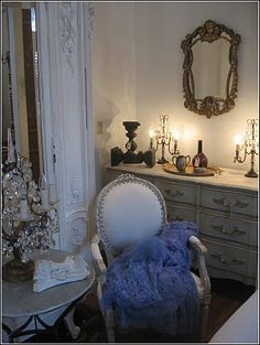 """A corner view of my so called ""bedroom"" at the shop. The vintage dress on the chair was an ugly shade of white, irreparably yellowed by time. I died it this lovely aqua color and now it adds a bit of whimsy to the room."""