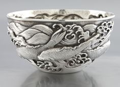 """Japanese export silver bowl featuring stylized koi fish hand chased to the body. Stamped to the bottom with characters. 4.705 ozt. 5""""D, Circa - 1900."""