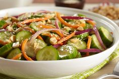 Try something new with our Japanese Cucumber Salad recipe. Our tangy Japanese Cucumber Salad includes carrots, peanuts and a touch of lime juice. Japanese Cucumber Salad, Persian Cucumber, English Cucumber, Salad Dressing Recipes, Salad Recipes, Food Dishes, Side Dishes, Cooking Instructions, Mets