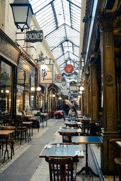 Photo of Passage des Panoramas, one of the most beautiful passages of Paris. Discover this passage on a self guided walking tour of Secret Paris! #Travel #France #Paris
