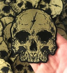 This is a high quality embroidered patch featuring my Lightning Skull design. This patch is approximately x and features a heat transfer backing. All orders come with free stickers. Cool Patches, Pin And Patches, Skull Patches, Jacket Patches, Cat Skull, Gold Skull, Tactical Patches, Tactical Gear, Learn Embroidery