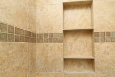 Simple and nice-built-in shelves and tile were placed in this downstairs bathroom.