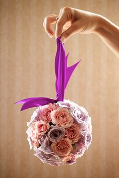 light pink and purple pomander with a purple ribbon - wedding photo by top Philadelphia based wedding photographers Langdon Photography