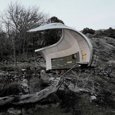 This chicken coop by Swedish architect and designerTorsten Ottesjö is designed to look like the protective wing of a mother hen.