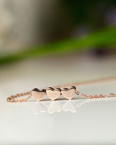 Three Hearts Rose Gold Necklace. I would really love this for my three best friends. It's so cute!