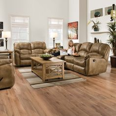 Leather reclining sofa and love seat in Almond. #furniture #livingroom