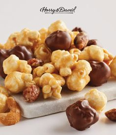 The perfect combination of caramel, chocolate, and crunchy nuts. Treat yourself to a bowl of Moose Munch! This gourmet popcorn is sweet and salty. Made in our Harry & David candy kitchen, it's blended with sweet, smooth caramel, crunchy popcorn, and nuts. Shop the full Moose Munch Collection for any occasion, like birthday, thank you, I love you, congratulations, sympathy, anniversary... and just because!