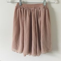 XS/S American Apparel tan chiffon skirt XS/S American Apparel tan chiffon skirt. Elastic waistband. There is a small mark on the skirt as pictured but not visible when wearing skirt. American Apparel Skirts Circle & Skater
