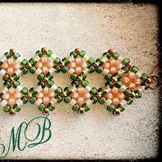"""Used Beadifulnights tutorial """"snazzy beaded bracelet"""" Added another row and used 11/0 seed beeds"""
