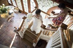 With help from her hairdresser, Bobbie Thomas descends the stairs in Kathie Lee's home.