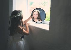 "Final hairdo check in the mirror for this blissful flower girl, she has to be perfect, the queen bride is about to comes. I know what is thinking this cute flower girl "" One day I'll wear the dress of my dream and I will get married like her"". Photo Phillip French"