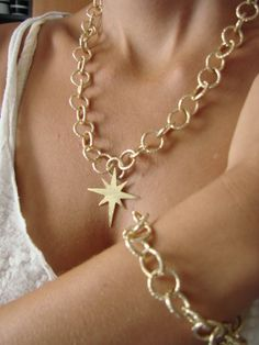 North star pendant on fine gold plated chain , assembled by chain bracelet  just for the detail...